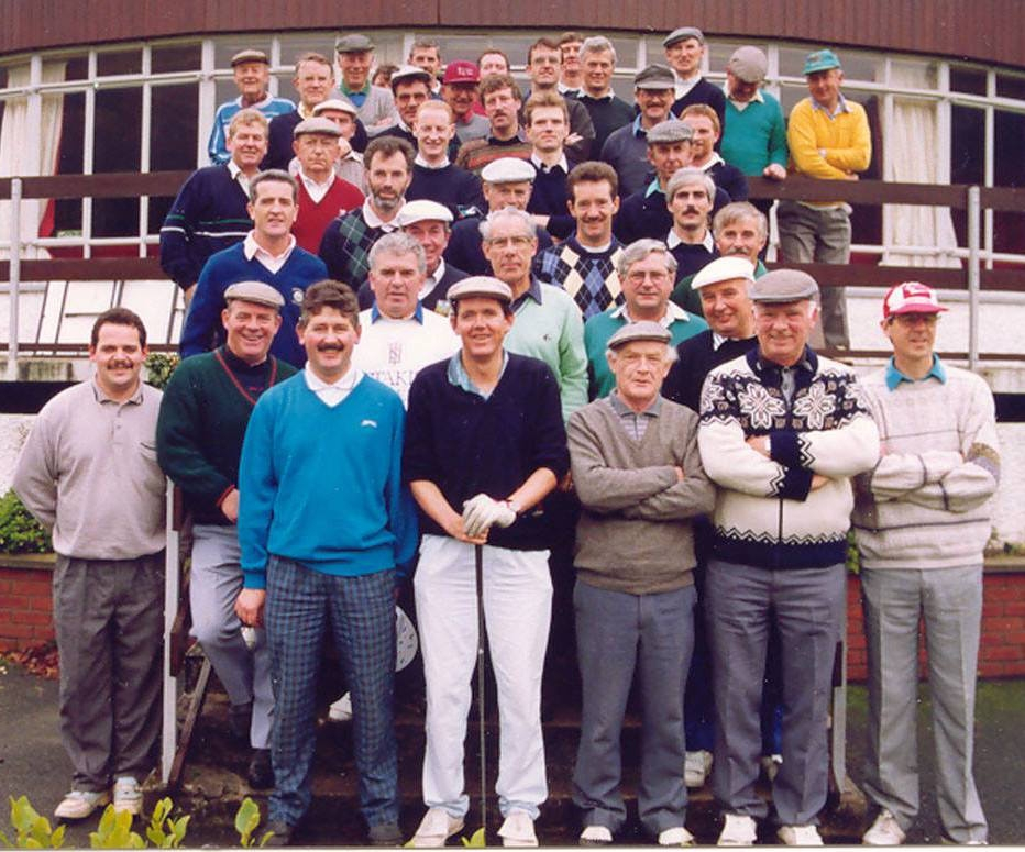 This photo was taken in 1992, of the ESB Dublin South Golfing Society President's Day group at Woodenbridge Golf Club, Co. Wicklow. Front row, left to right: Brendan O'Connor, John Kieran, Brian Convery, Tom Connolly, Phillip Higgins. Second row: Unknown, Sean Murphy, John O'Dowd, John Baily, Vincent Dowling, Unknown. Third row: Ray Lucy, Brendan Jacob, Donal Doran, Fintan McMerriman, Noel Kavanagh, Liam Monahan. Forth row: Jessie Lewis, Unknown, Peter Doyle, Chris McEntaggart, Vincent Leonard, Adrian Harney, Paddy O'Neill, John McCarthy. Back Row: Unknown, Unknown, Des Tynan, Jimmy Bennett, Denis Brown, Tommy Kane, Unknown, Unknown, Brendan Dowling, Jim Dowling, Ted McSweeney, Unknown, Joss Mooney. Many thanks to Michael Hughes and to Alan Thompson, ESB Networks, Leopardstown for providing this photo and to Liam Monahan for identifying most of the group members, some who are now deceased, R.I.P.