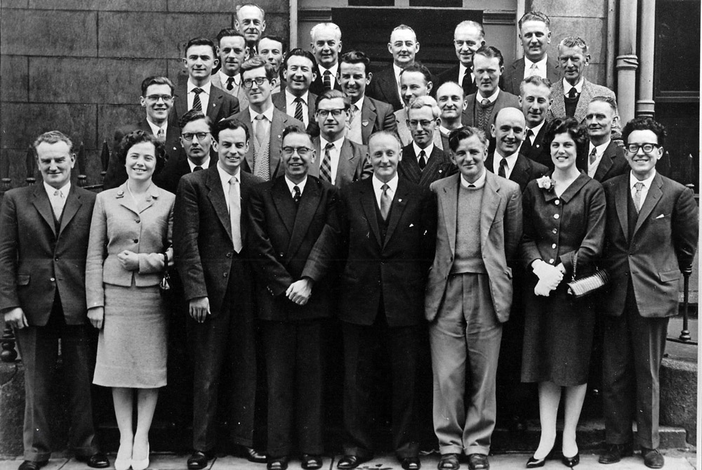 ESBOA First National Executive Meeting 1959 I'm looking for help to identify some of the delegates in the enclosed photo. The cluster of five top left and the middle two on the right beside the drain pipe. Replies please to ejkely@gmail.com.Any help will be greatly appreciated. Eddie Kelly Chairman Waterford RSA